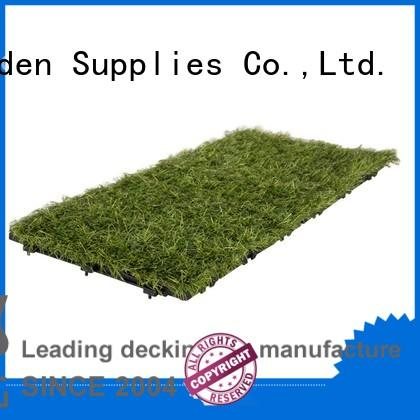 high-quality interlocking deck tiles on grass artificial grass path building